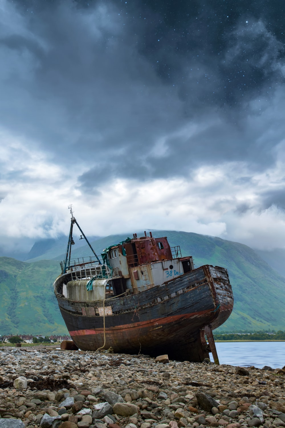 black and red ship on shore