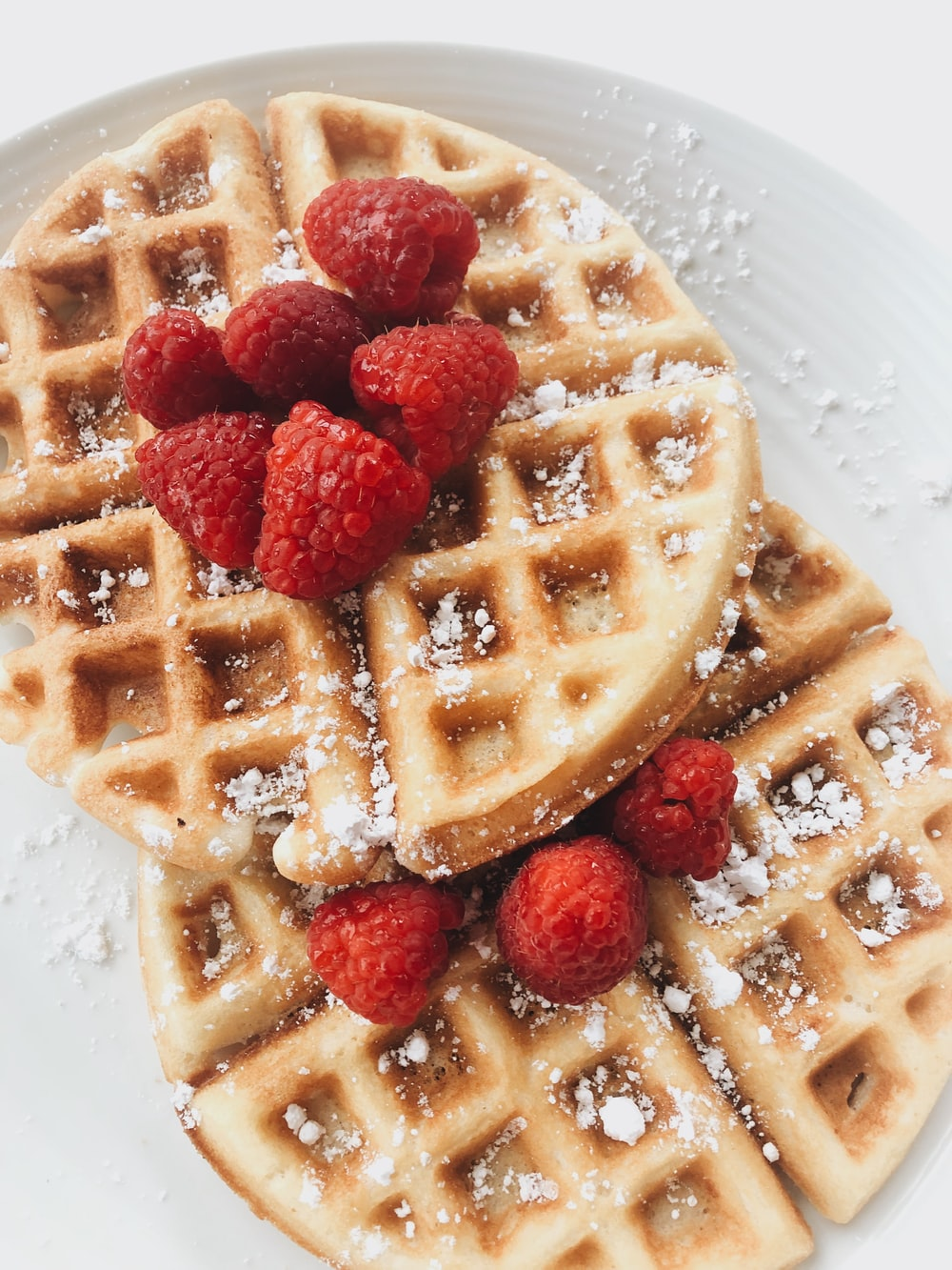 red strawberries on brown waffles