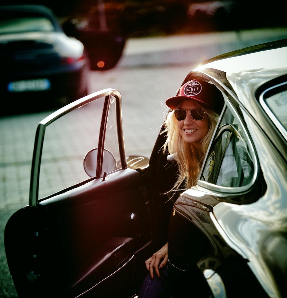 woman wearing black hat inside car