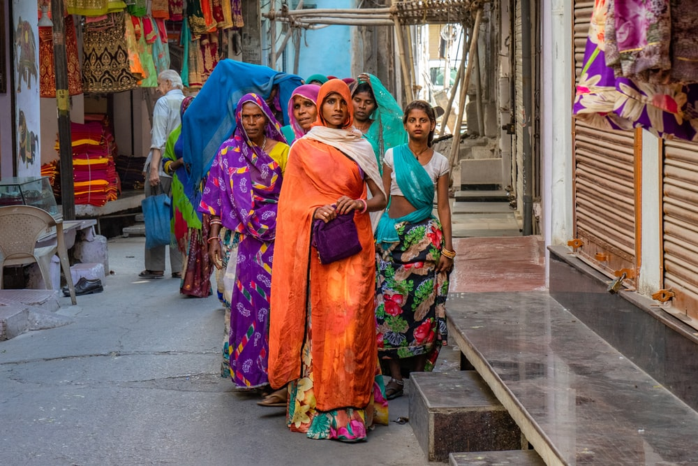 standing women wearing sari dress