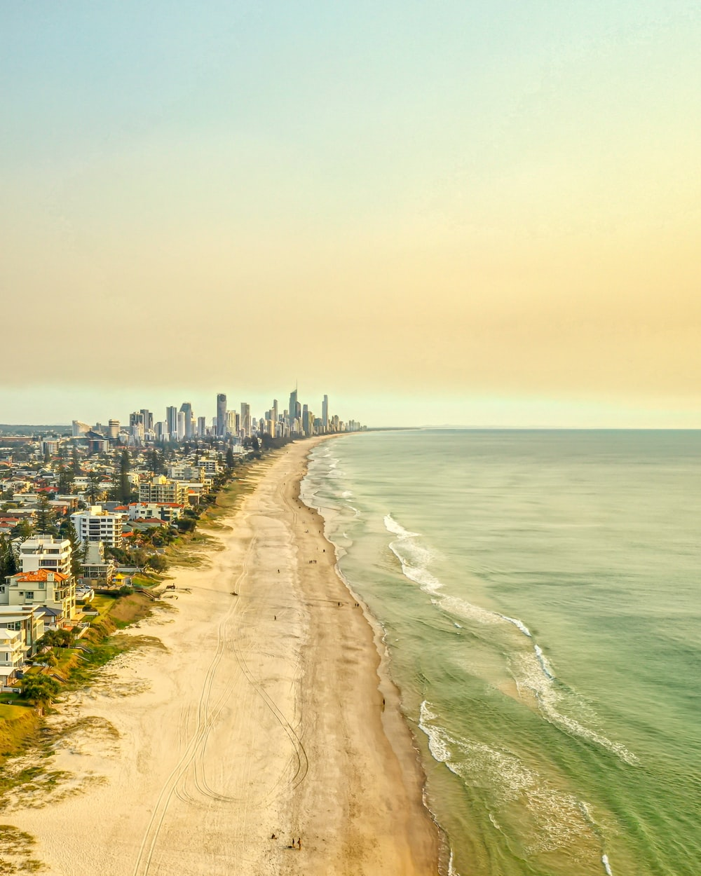 seashore besides city buildings photo