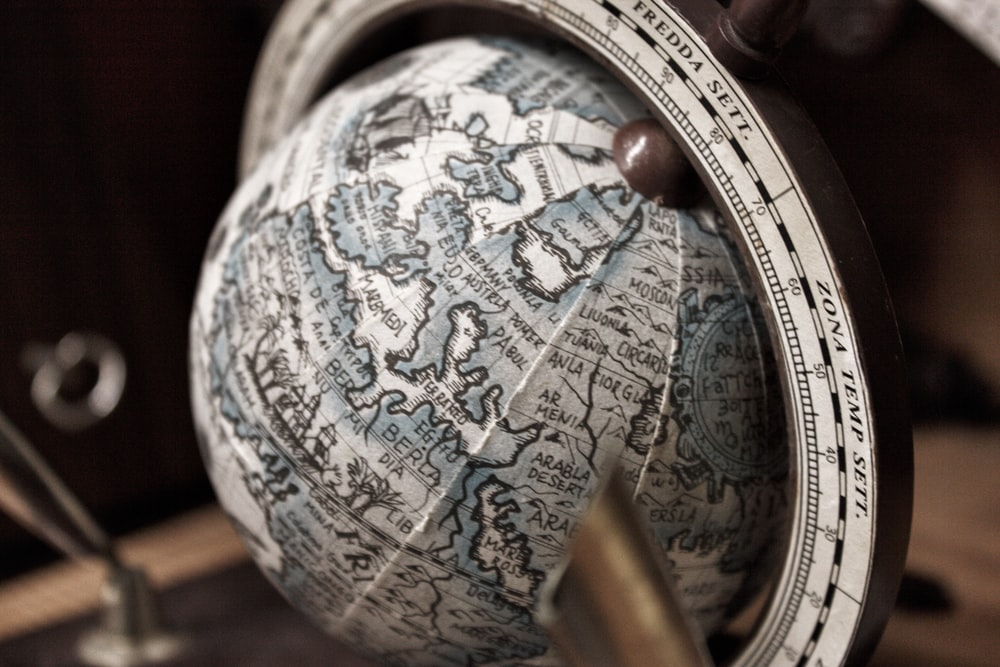 selective focus photography of white and gray desk globe