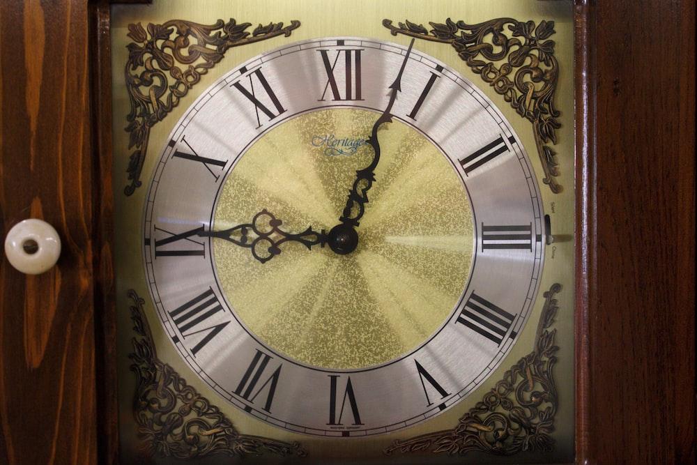 round black and gray analog clock
