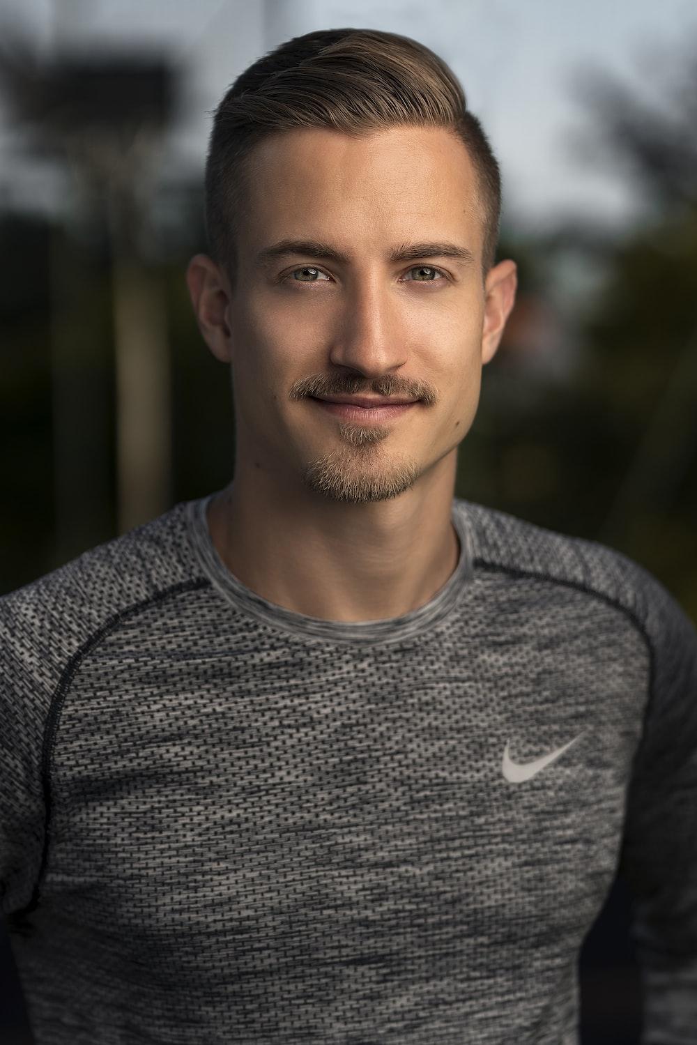 man in gray Nike top