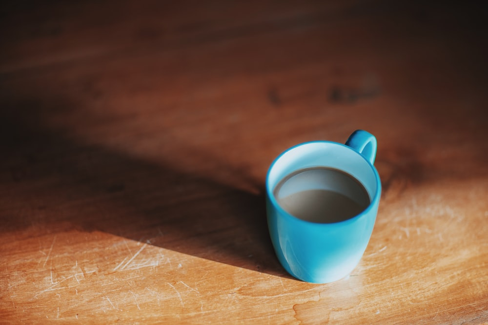 filled blue ceramic mug