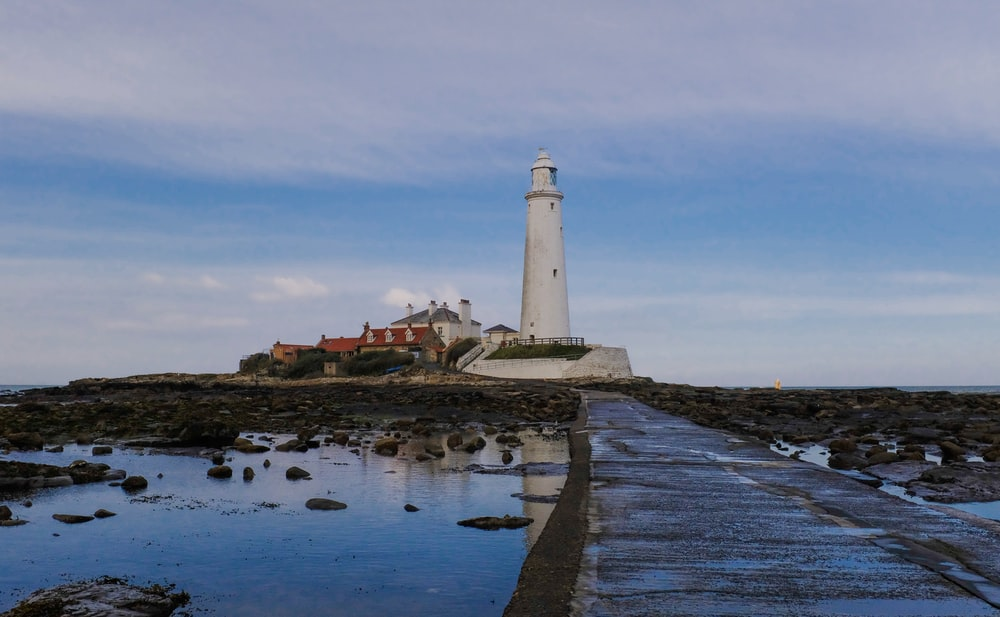 landscape photography of a white lighthouse
