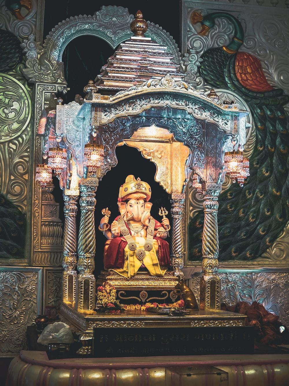 shallow focus photo of Ganesha Hindu god statue