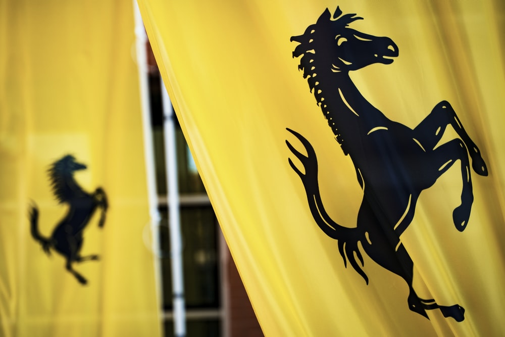 black horse logo printed on yellow curtain