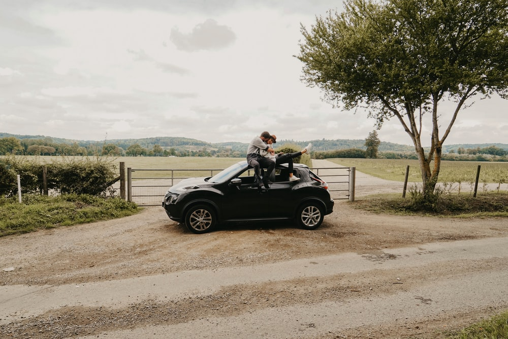 two people on top of vehicle