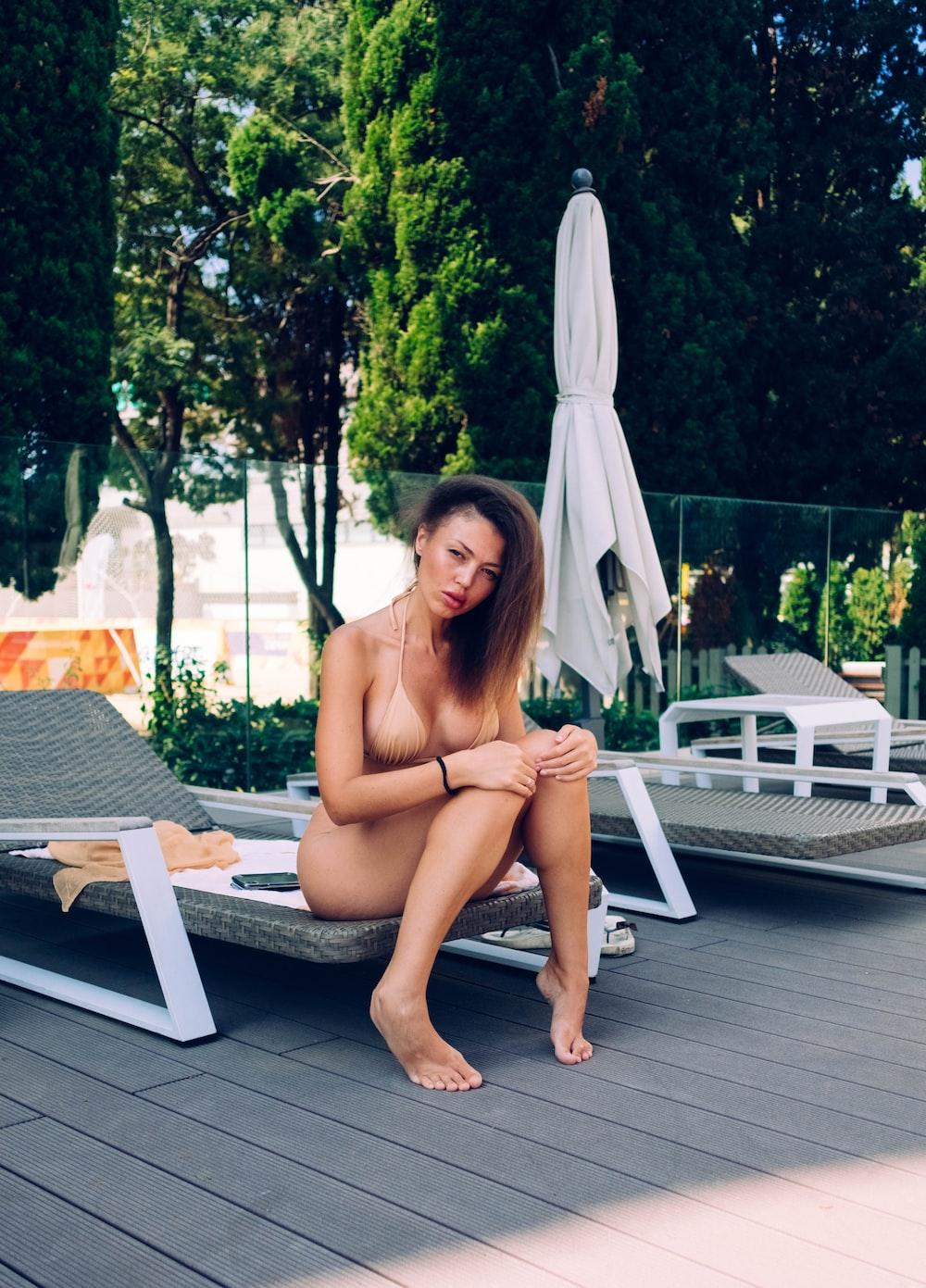 woman sitting on lounge during daytime
