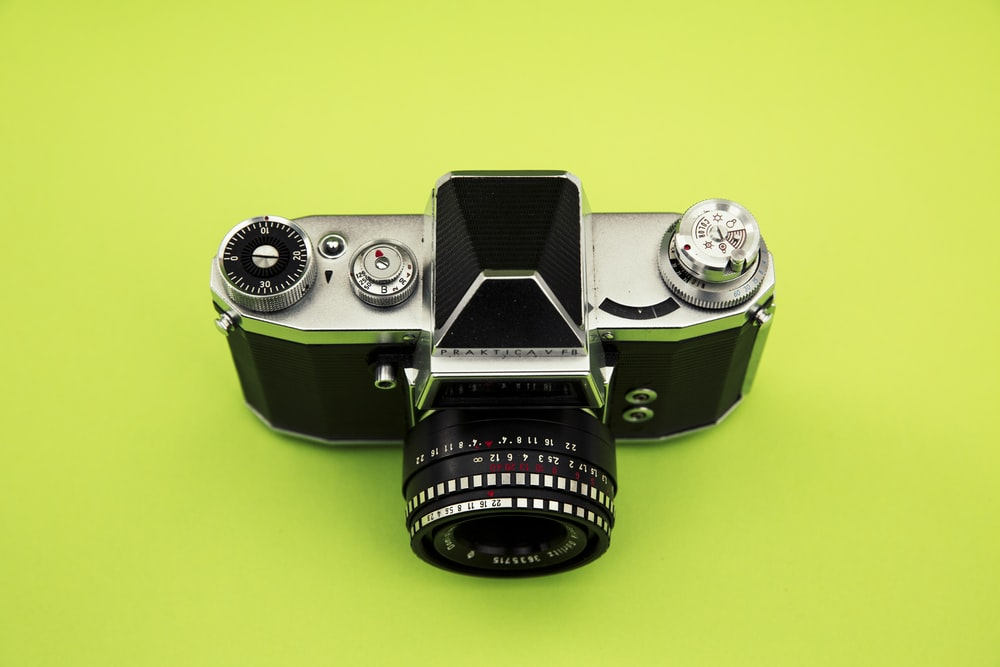 black and grey camera on green surface
