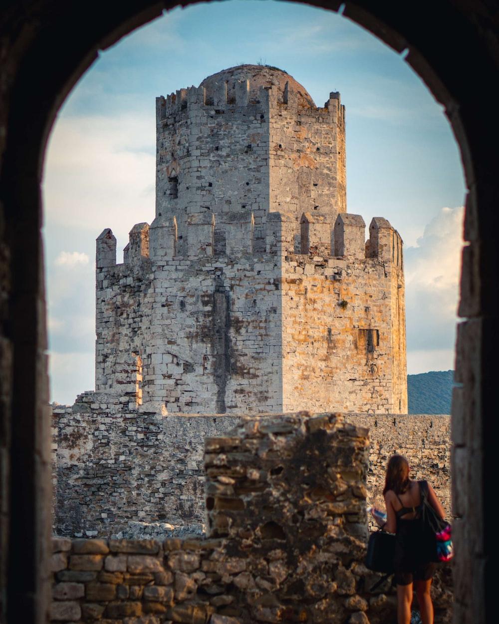 woman standing near castle