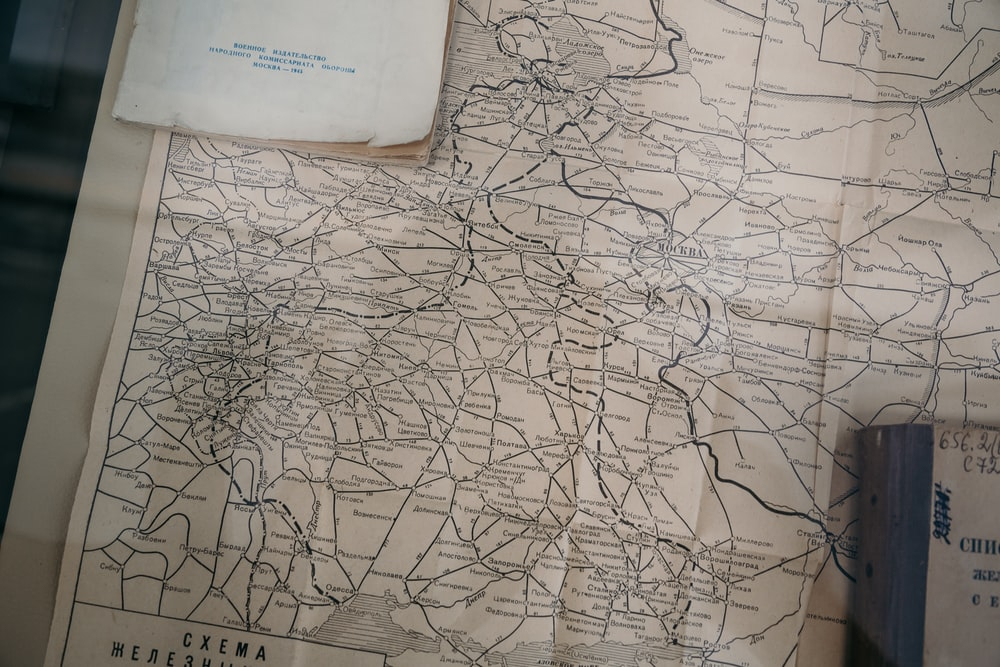 books on brown and gray map