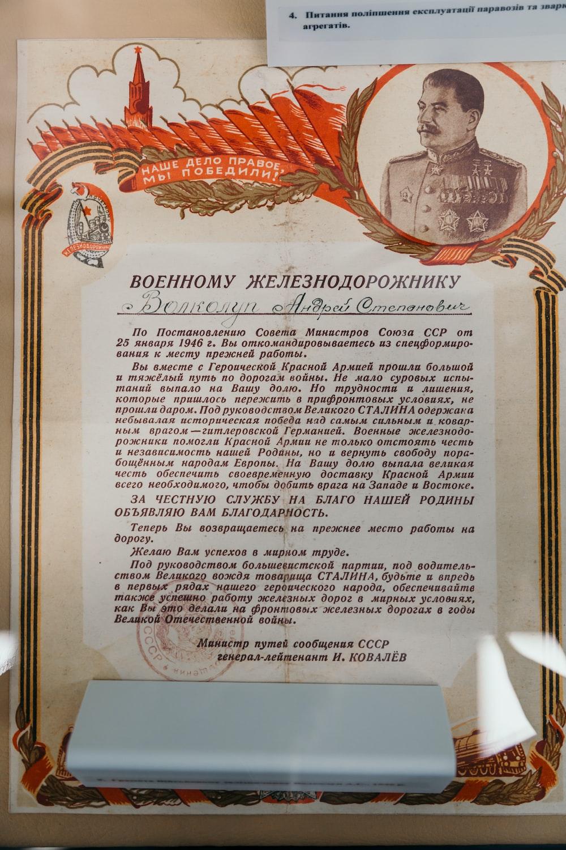 black print white and orange certificate