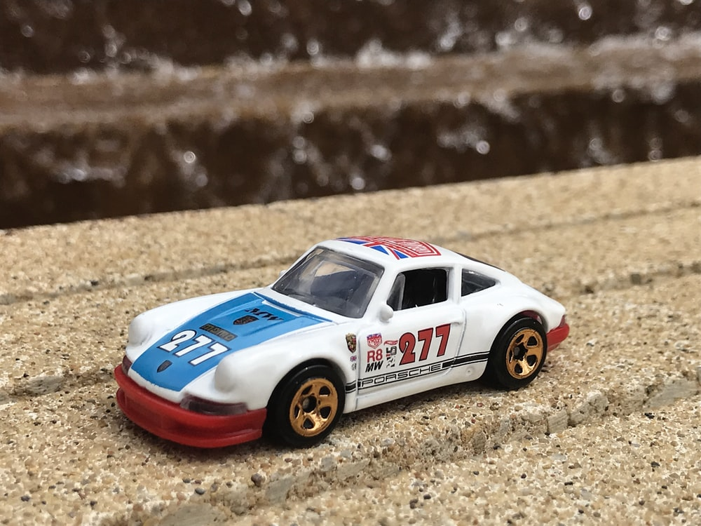 selective focus photography of white and blue 277 race coupe toy