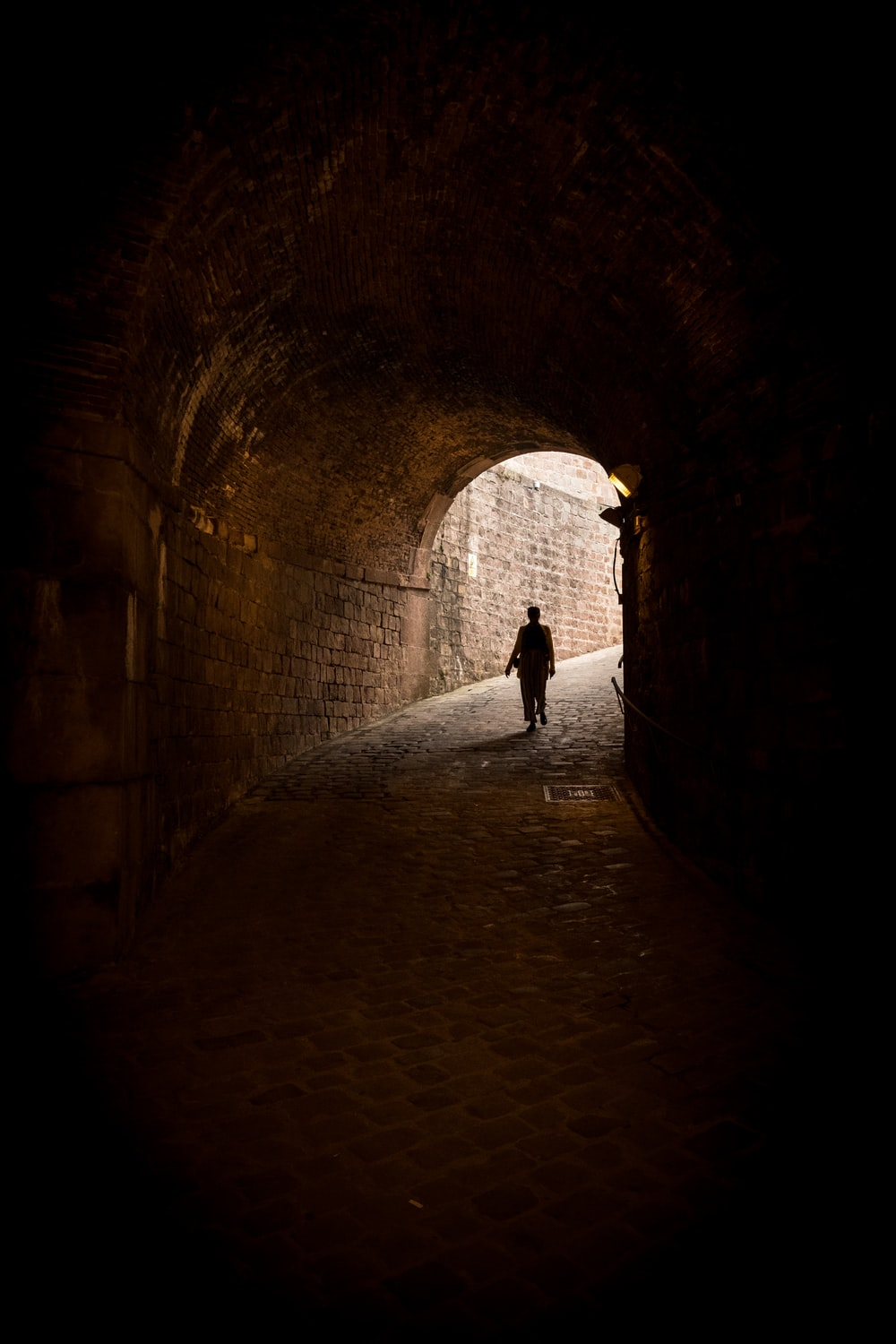 person standing under tunnel