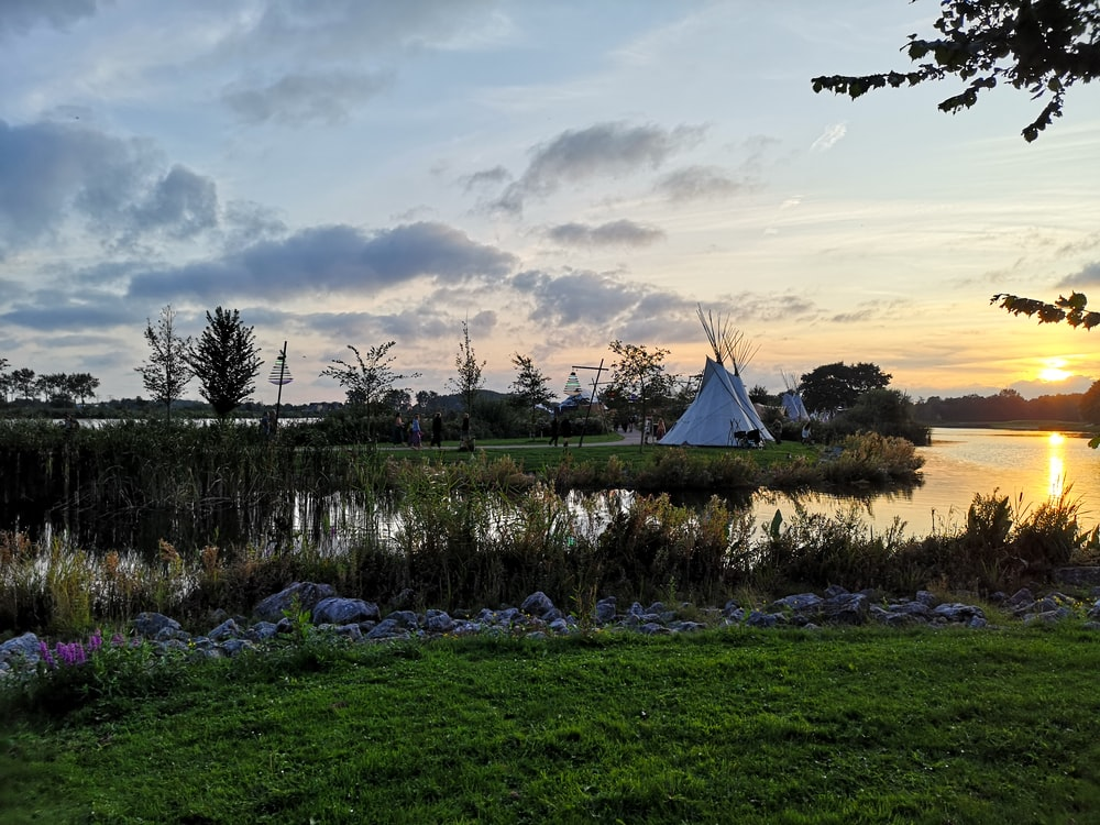 tipi tent facing body of water