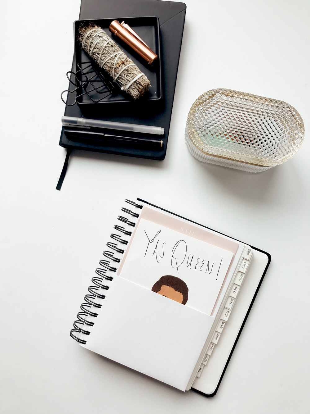 white and black spiral notebook