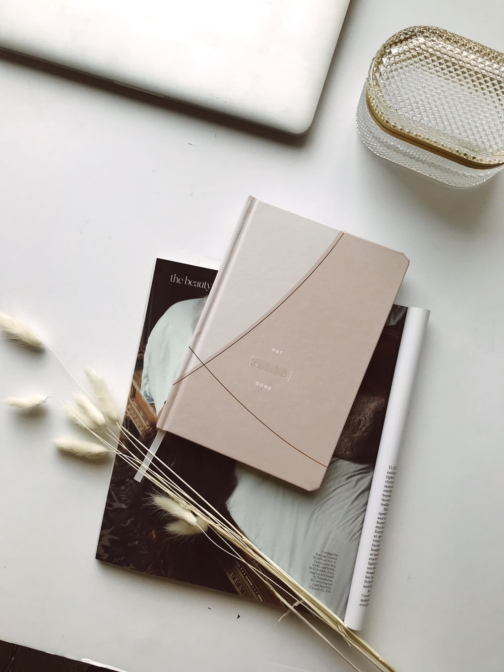 titled book on white surface