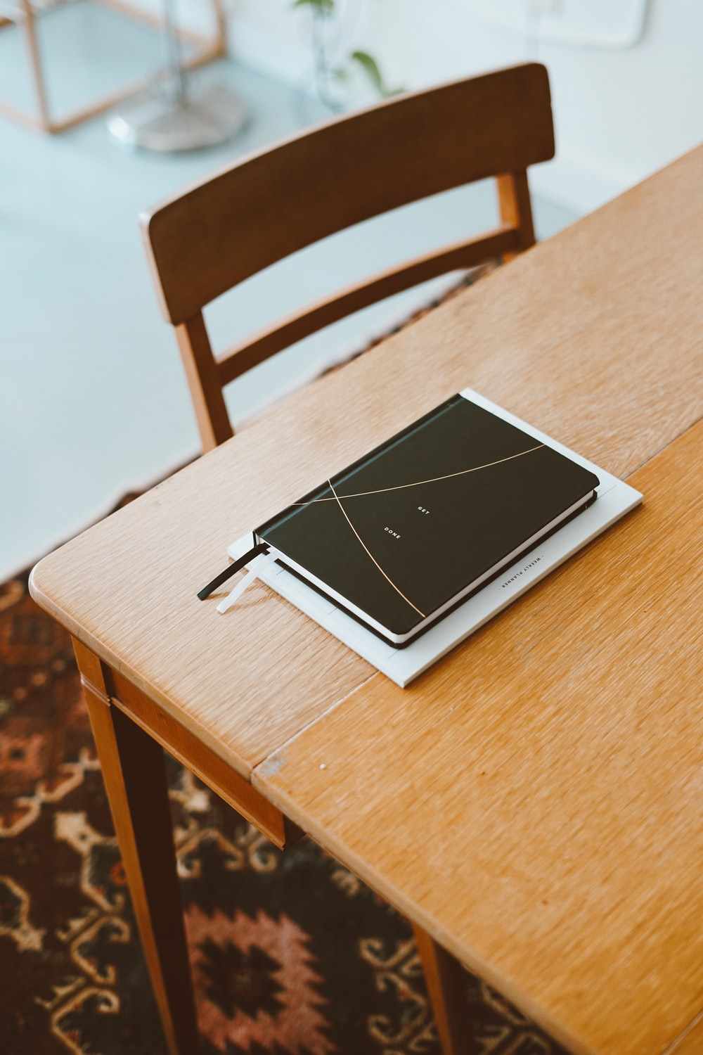 black planner on wooden table