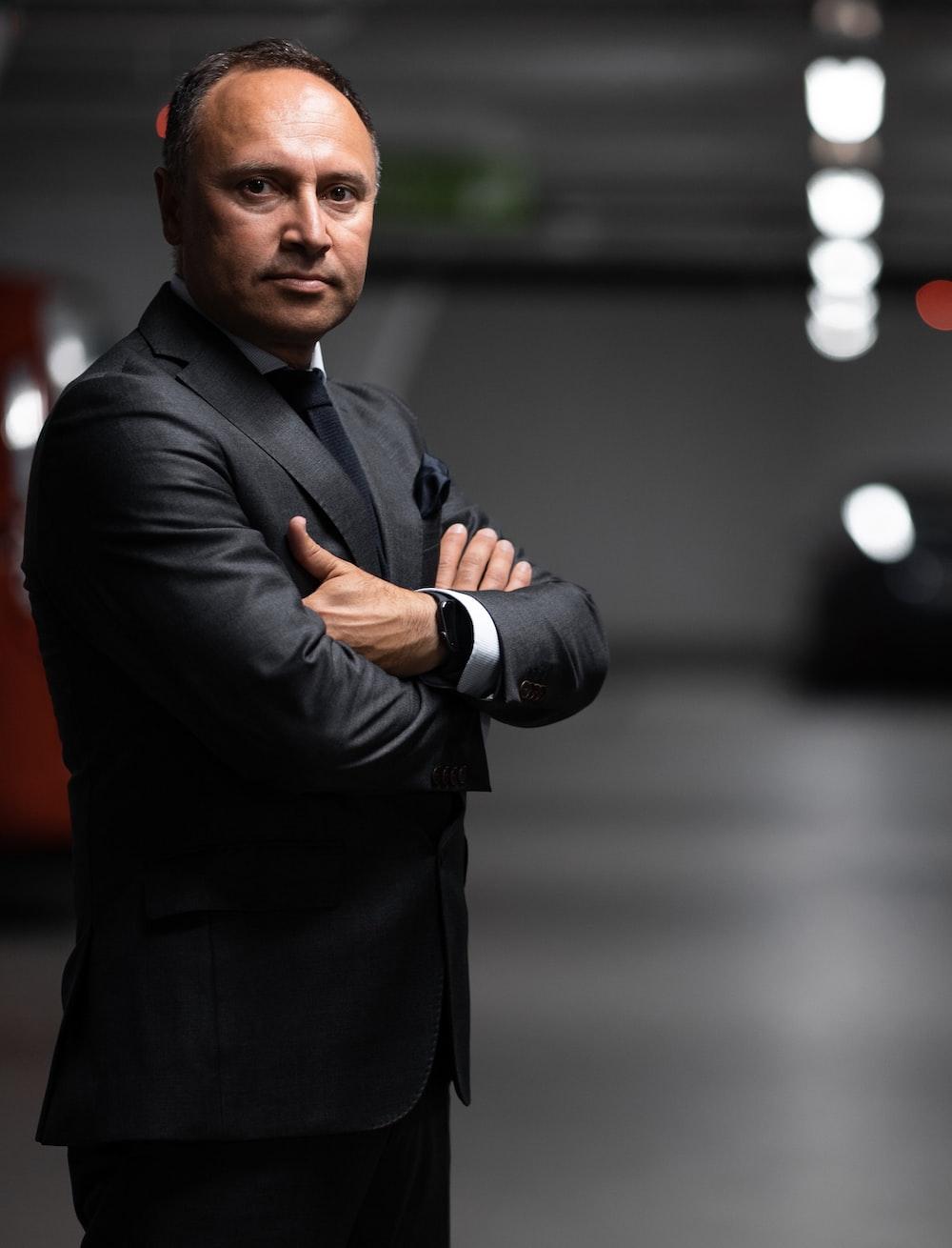 man wearing black dress suit