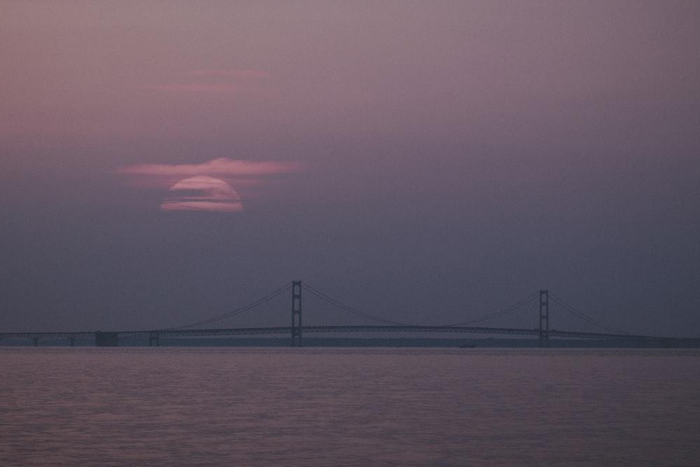 concrete bridge across sea at daytime