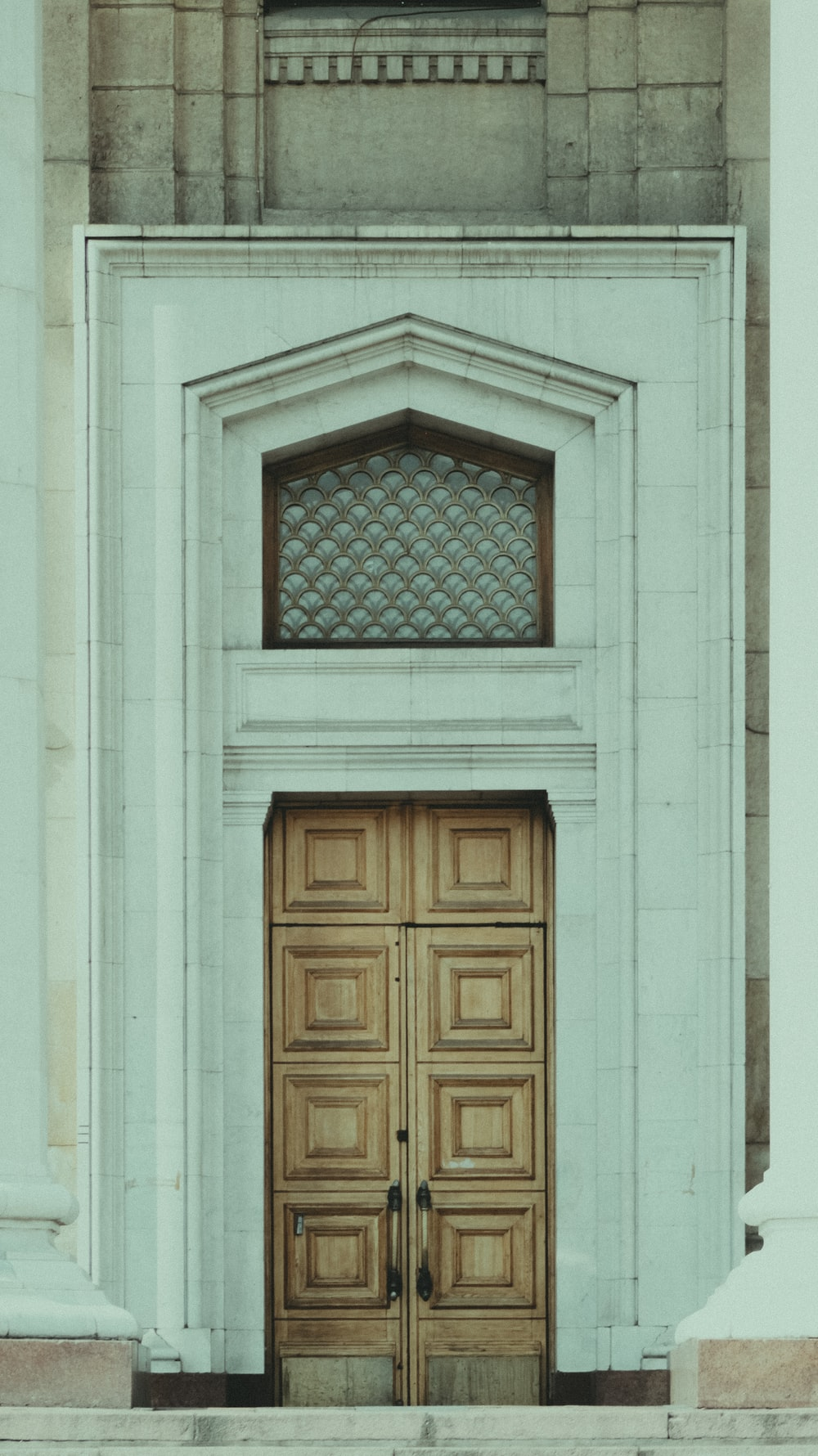 white concrete building showing closed door