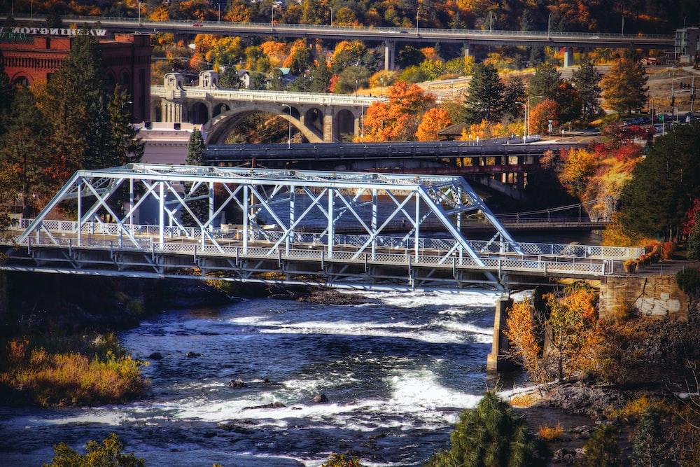 high-angle photography of gray metal bridge