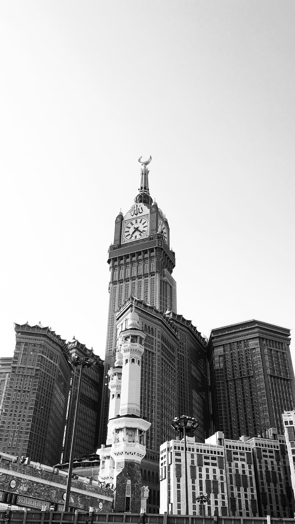 grayscale photo of buildings and a tower