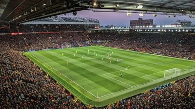 aerial photography of a football stadium filled with people manchester united zoom background