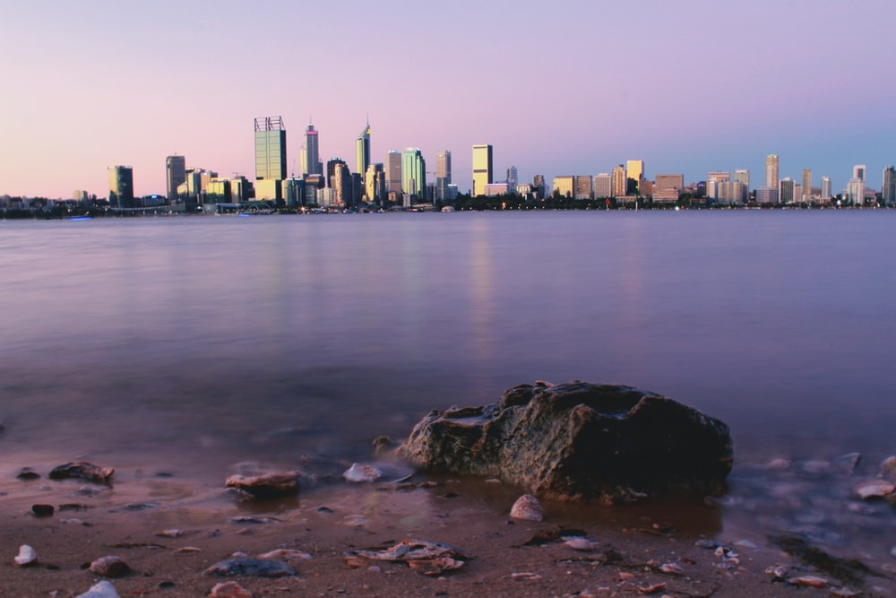 buildings beside sea during daytime