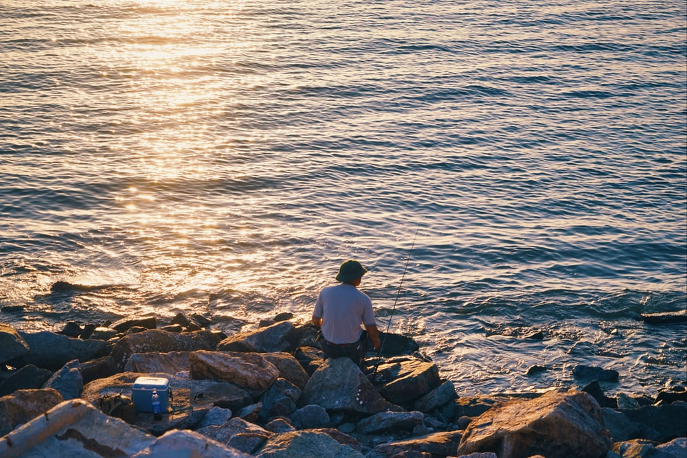 person sitting on rocks