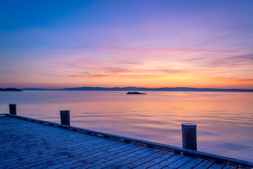 gray wooden dock during golden hour