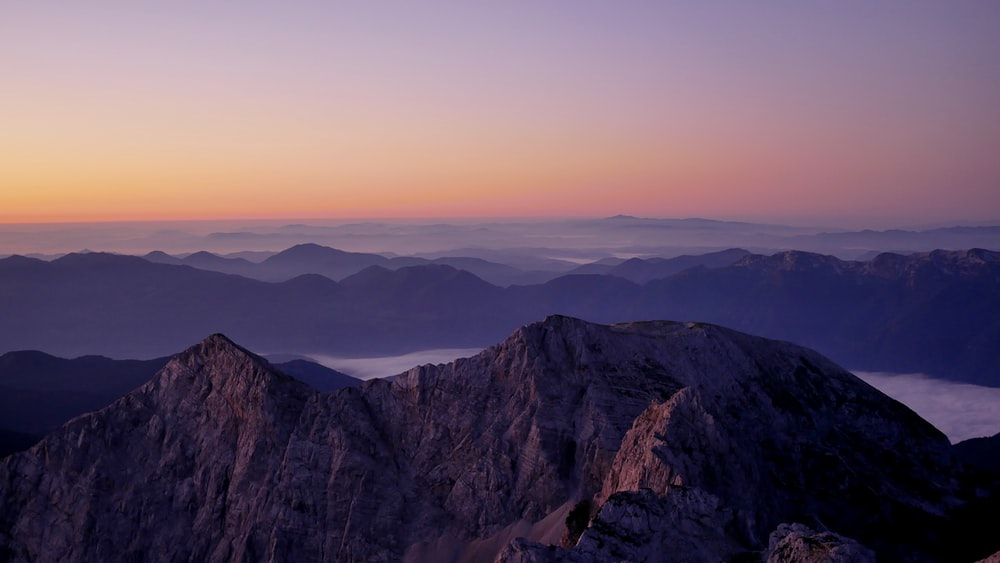 aerial photography of mountains during golden hour