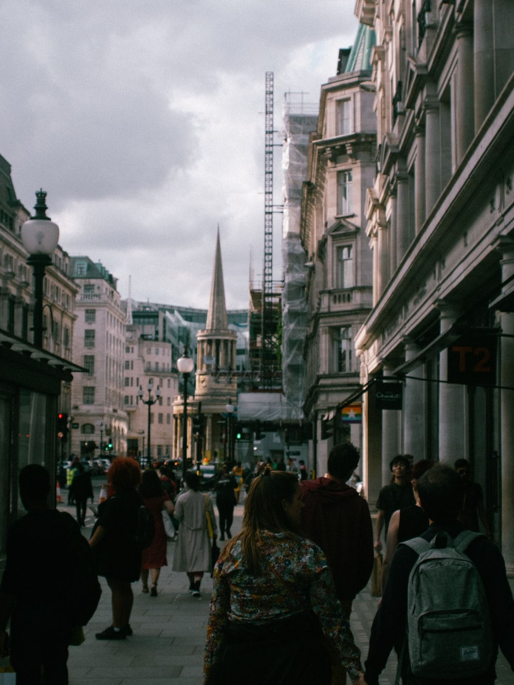 people surrounded by buildings