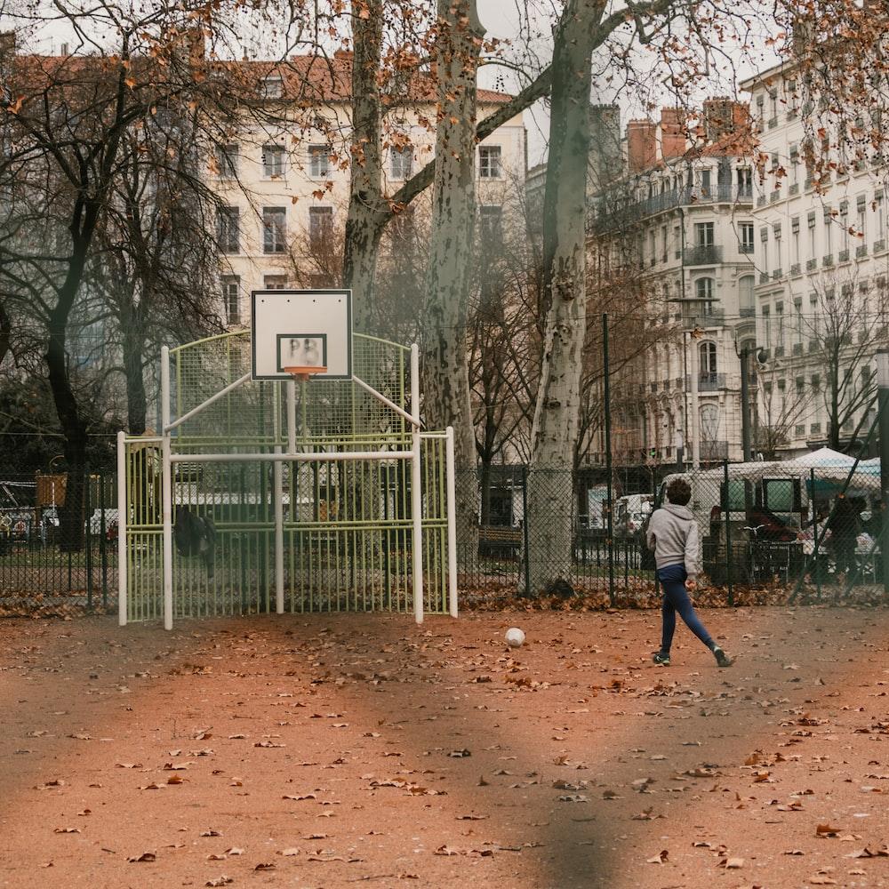 boy standing near basketball hoop
