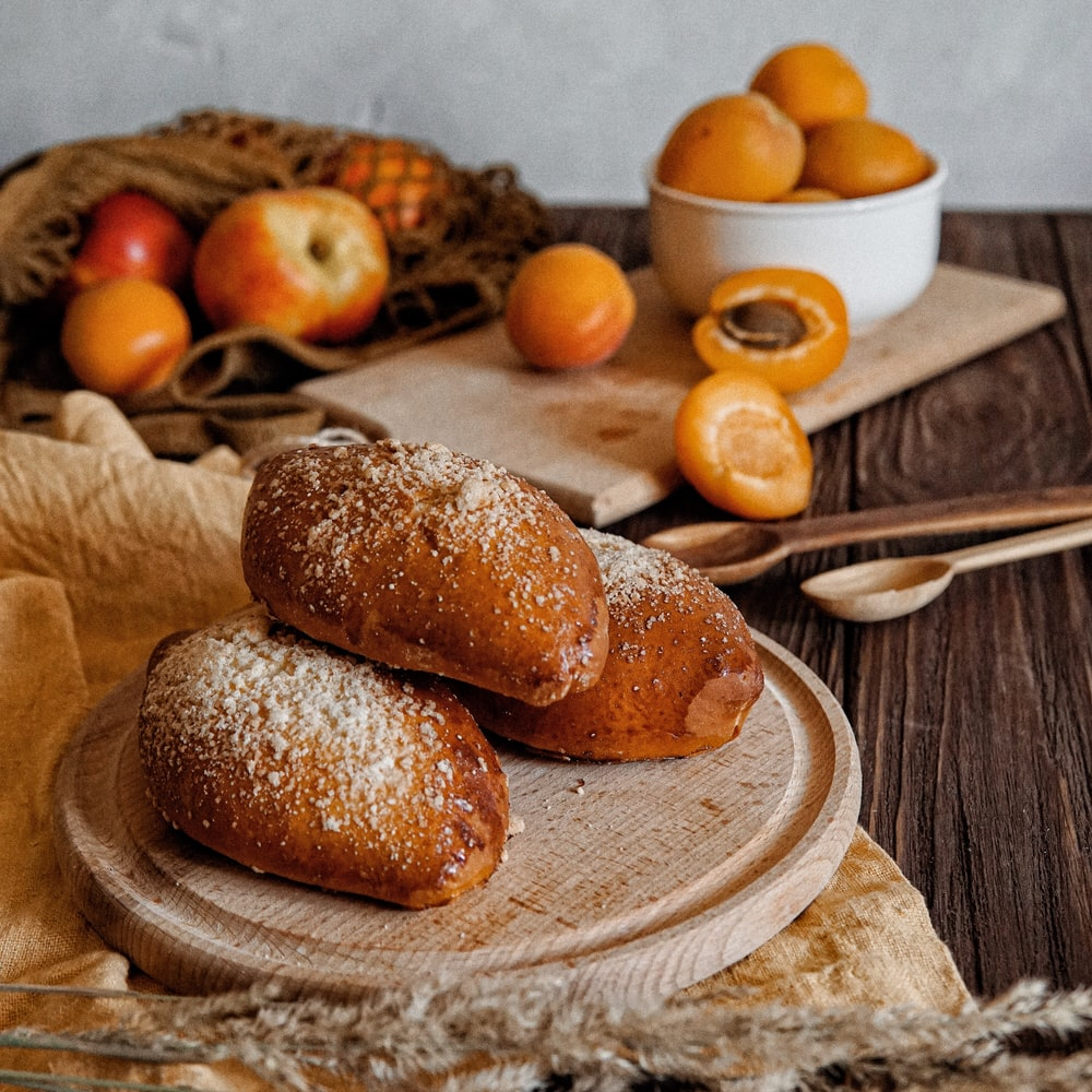 baked breads on cutting board