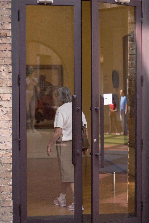 woman walking inside building