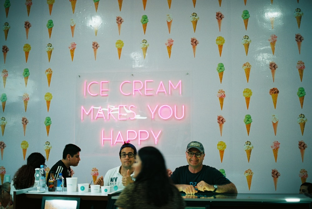 group of men and women inside ice cream restaurant