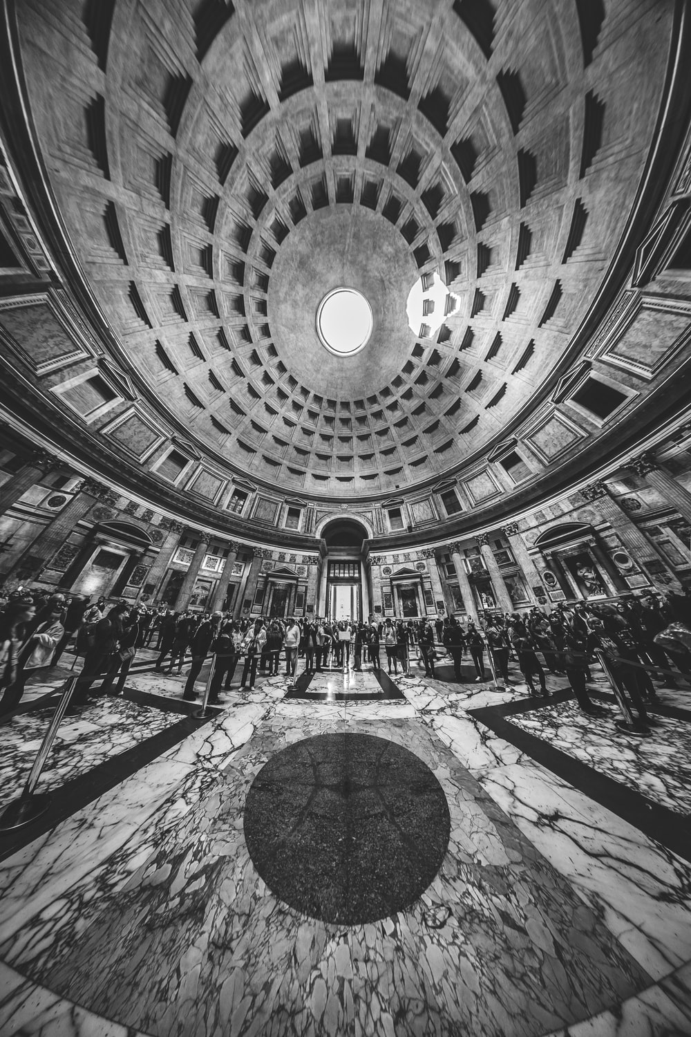 grayscale photography of people inside Pantheon temple in Rome, Italy