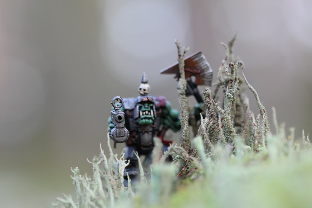 closeup photography of character with gun action figure