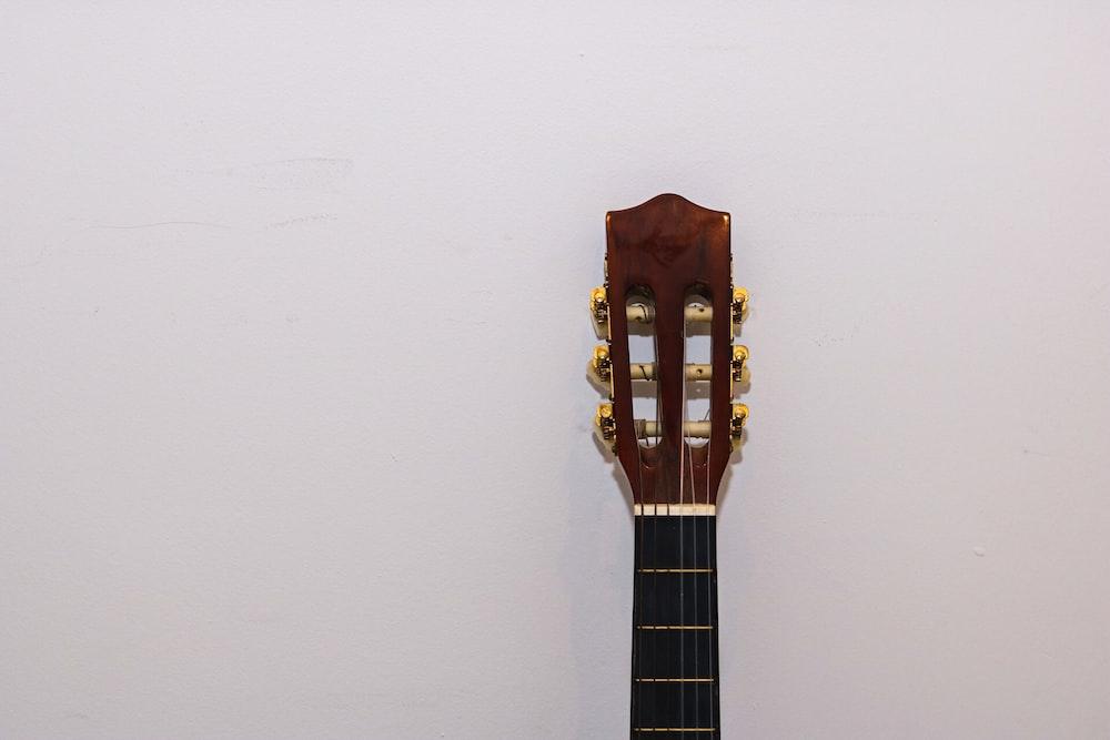brown and black guitar headstock