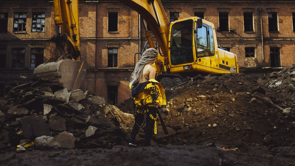 woman near the excavator