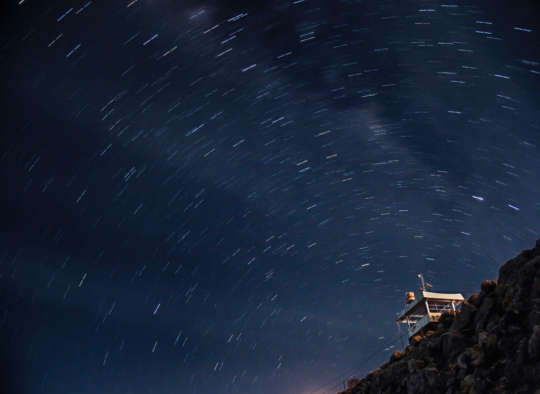 Star trails appear above the building. Long exposure photography