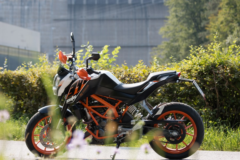 black and orange sports bike