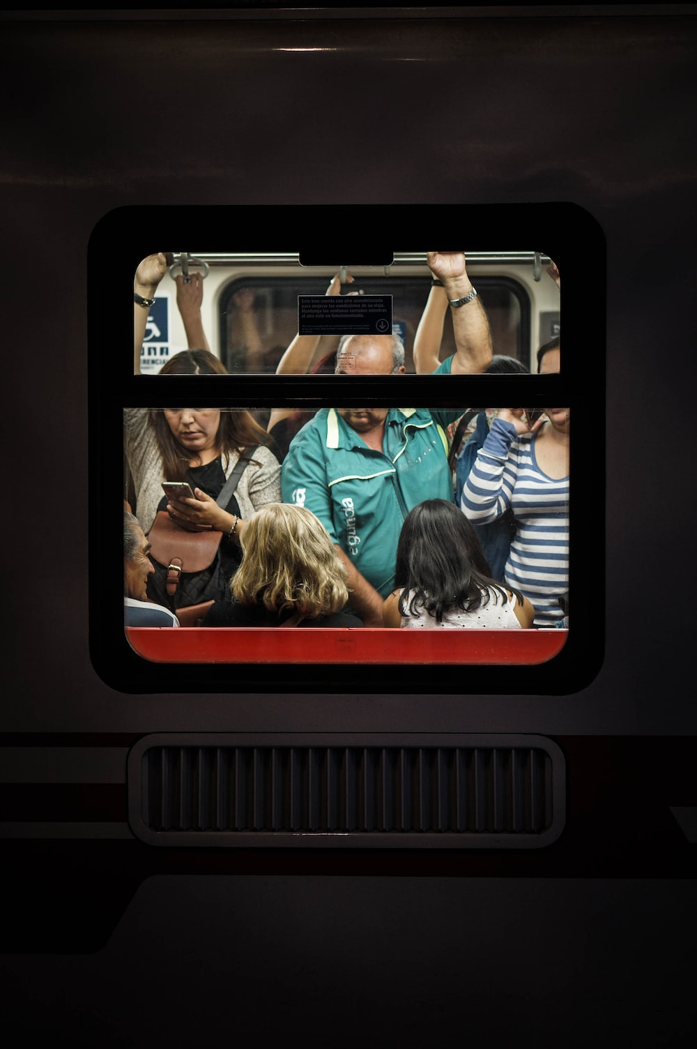 people standing in a train car