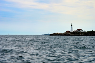white lighthouse maine teams background