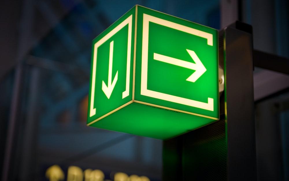powered-on green arrow signage box
