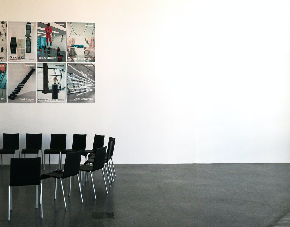 black chairs beside wall