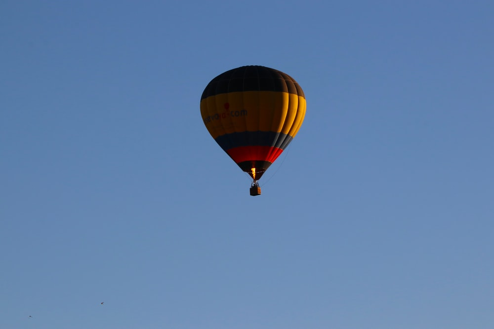 red, blue, and black hot air balloon